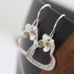 silver heart earrings with daisies