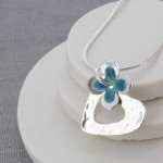 personalised blue and silver daisy pendant