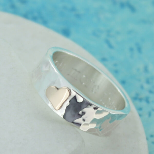 Hammered silver ring with gold heart