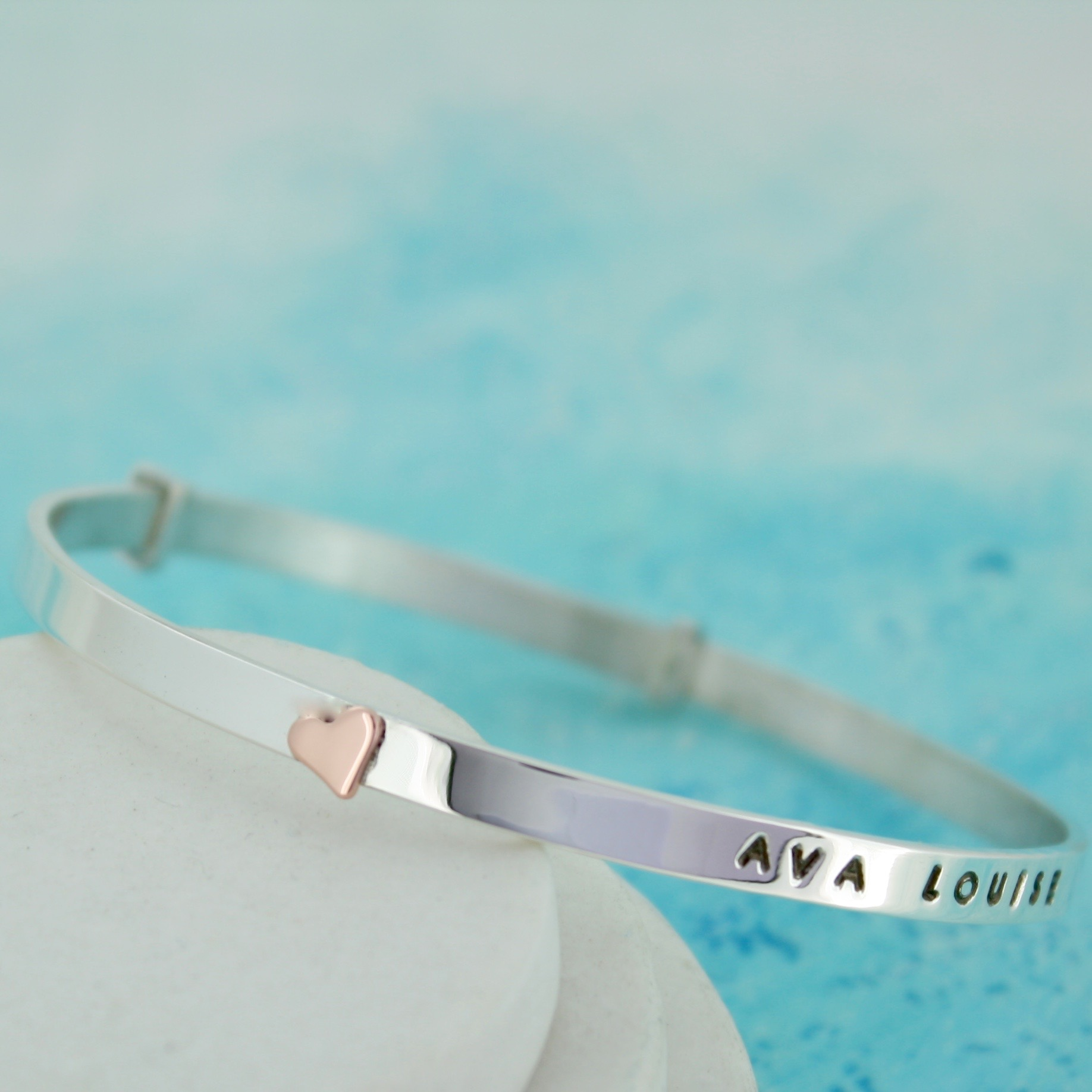personalised silver bangle with gold heart