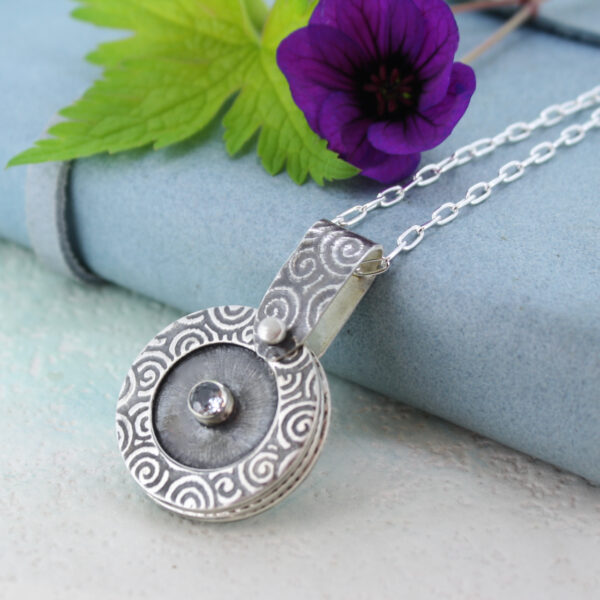 handmade textured silver photo locket with aquamarine