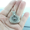 silver textured photo locket with aquamarine