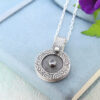 handmade textured silver photo locket with aquamarine