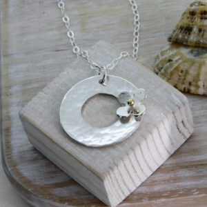 Personalised Silver disc pendant with daisy
